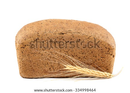 Bread and wheat ears isolated on white background. - stock photo