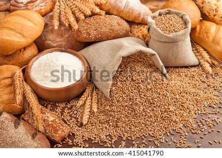 bread and wheat in bags  on the table. - stock photo