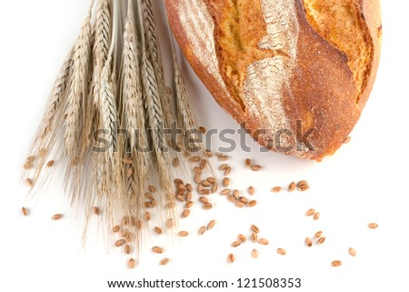 Bread and wheat isolated on white background