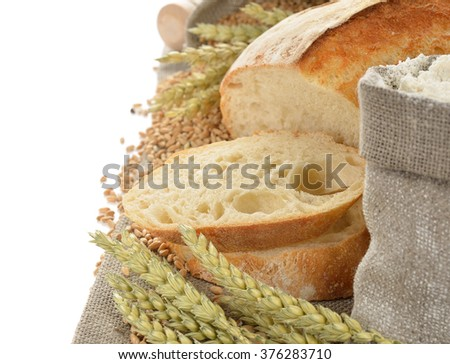 Bread and wheat on the white background - stock photo