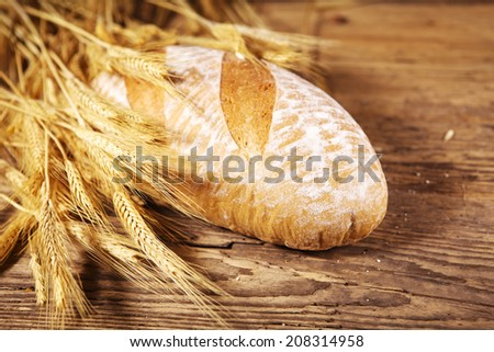 bread and wheat on wood