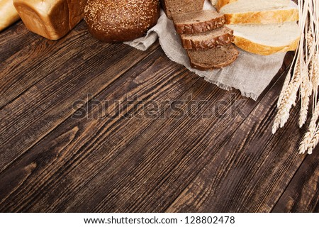 Bread assortment on a wooden table - stock photo