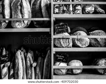Bread, baguettes, sourdoughs, brioches, all freshly baked on a Sunday morning ready for the rush of customers at this bakery. - stock photo