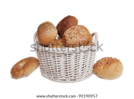 Bread Basked full of Delicious Bread isolated on white - stock photo