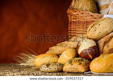 bread basket and bun in traditional still-life on wood table with grain and wheat and flour