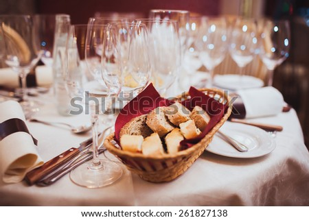 bread basket on the table in a restaurant - stock photo