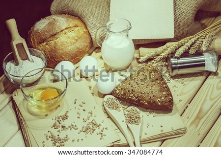 Bread.  Bread, Grain and spikelets on wooden table. Vintage.  - stock photo