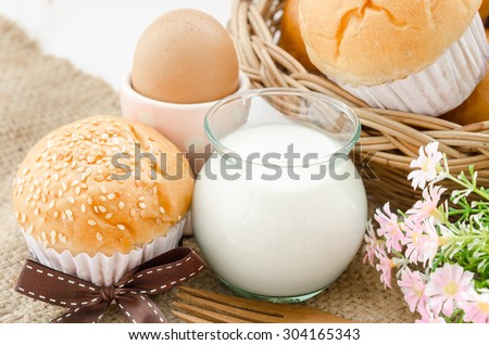 bread bun with white sesame and milk on sack background.