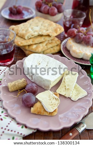 Bread, cheese and grapes - stock photo