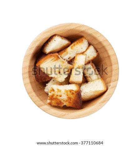 Bread croutons for caesar salad. Isolated on white background - stock photo
