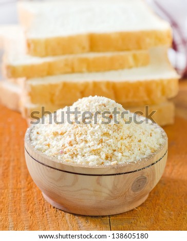 Bread crumbs on white kitchen bowl - stock photo