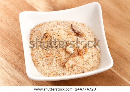 bread crumbs on wooden table  - stock photo