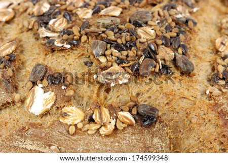 bread crust with seeds close up food background