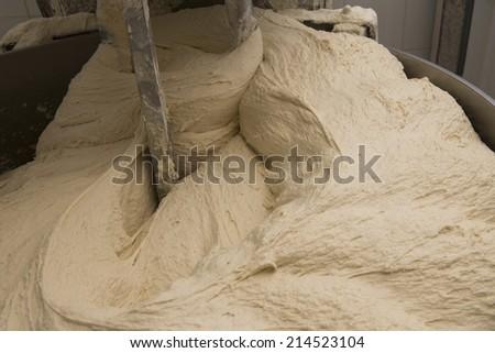 bread dough and mixer - stock photo