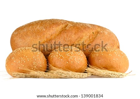 Bread, ears and three buns with sesame seeds on a white background