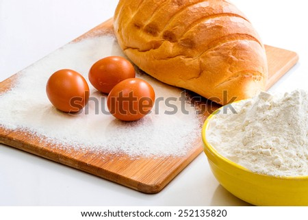 Bread flour and eggs - stock photo
