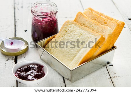 Bread for breakfast and a blueberry jam made more delicious - stock photo
