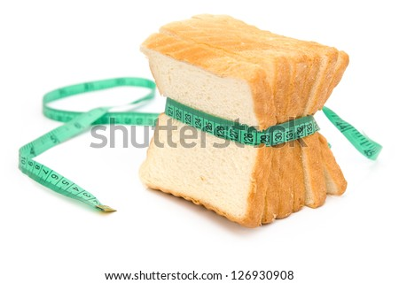 bread grasped by measuring tape, healthy eating and dieting concept - stock photo