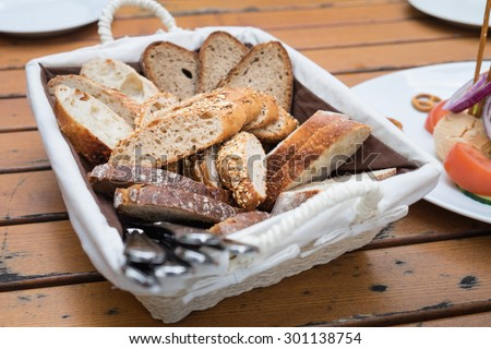 Bread in basket. - stock photo