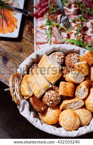 Bread in basket,  homemade cooking made from whole wheat and grains - stock photo