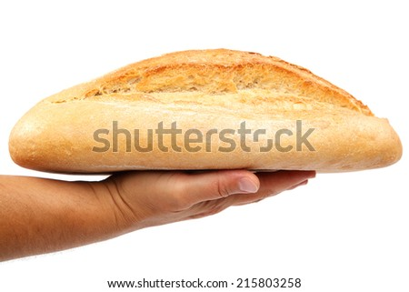 Bread in hand isolated on white background. - stock photo