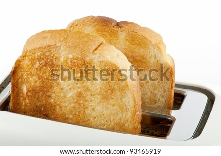 bread in the white toaster - stock photo