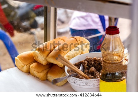 Bread is sold in a morning market in Laos - stock photo