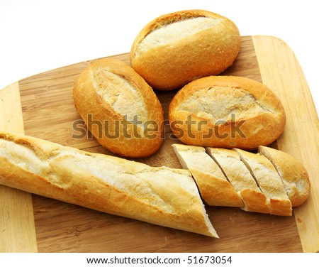 Bread on a wooden board, on a white background - stock photo