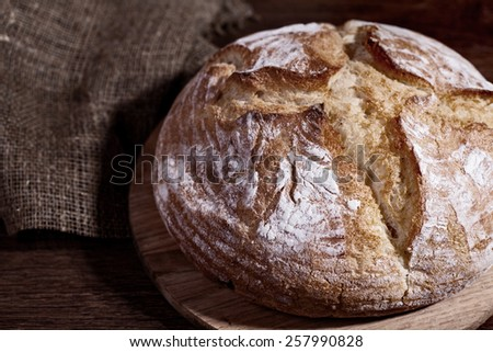 bread on a wooden table - stock photo