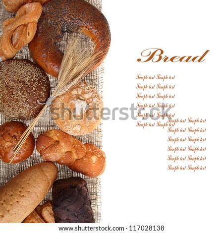 Bread on sacking isolated on white background - stock photo