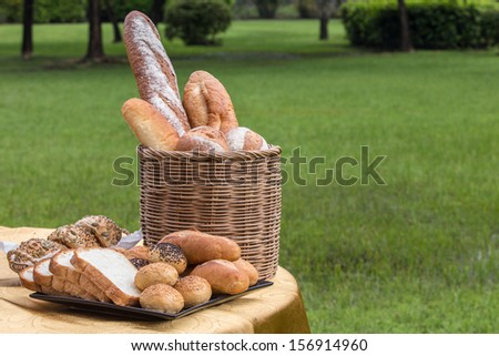 Bread on the table in the garden - stock photo