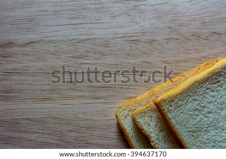 Bread on the wooden floor. wooden background