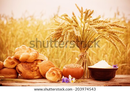 bread on the wooden table at field