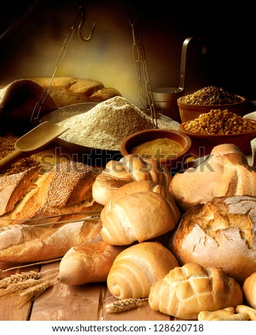 Bread on the wooden table with ingredients - stock photo