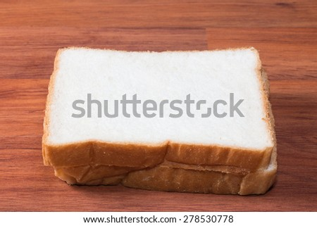 Bread on wooden table - stock photo