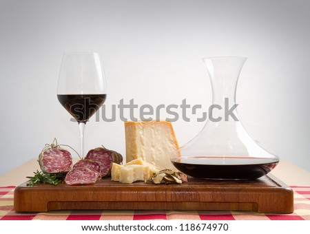 bread parmesan cheese  salami and red  wine - stock photo