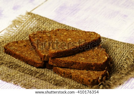 bread placed on a wooden slope in the background .Rustic style. - stock photo