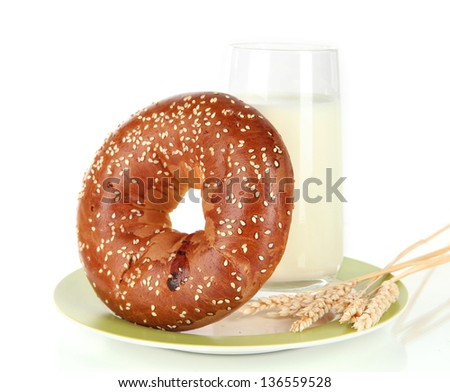 Bread roll and glass of milk isolated on white - stock photo