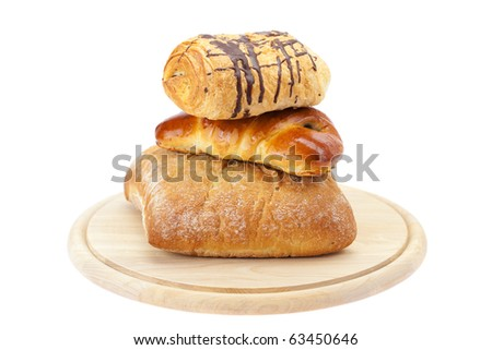 bread, Roll with poppy seeds and roll with chocolate on a cutting board isolated on white