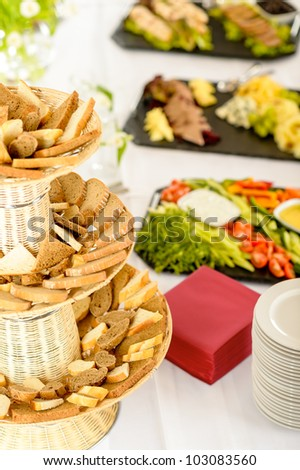 Bread selection catering buffet served food on white tablecloth - stock photo