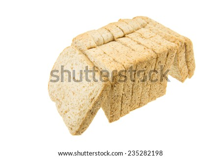 Bread - sliced original whole wheat loaf on white background - stock photo