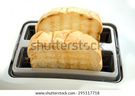 Bread slices in toaster close-up photo - stock photo