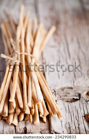bread sticks grissini torinesi closeup on rustic wooden board