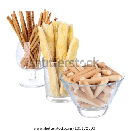 Bread sticks in glasses isolated on white