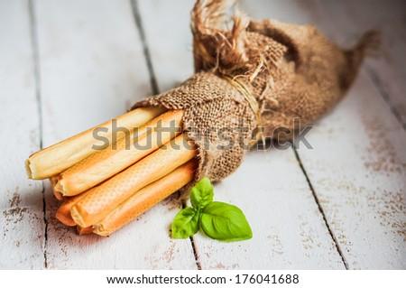 Bread sticks on wooden background - stock photo