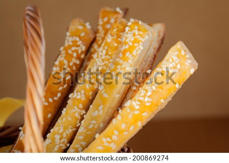 Bread sticks  with cheese and sesame, close up - stock photo