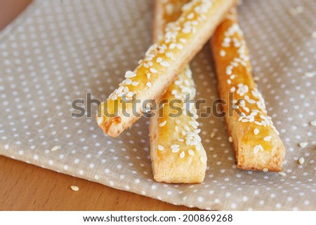 Bread sticks  with cheese and sesame on  the napkin, close up - stock photo