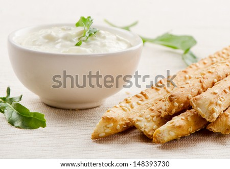 Bread sticks with sauce . Selective focus