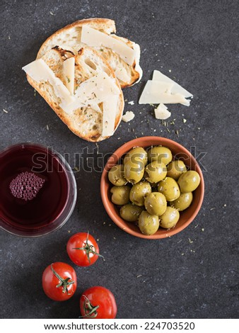 Bread, Wine and Olives. Shallow Depth of Field. Selective Focus. - stock photo