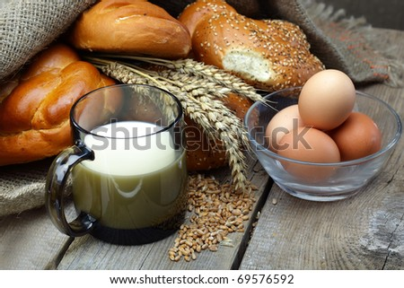 Bread with a mug of milk - stock photo